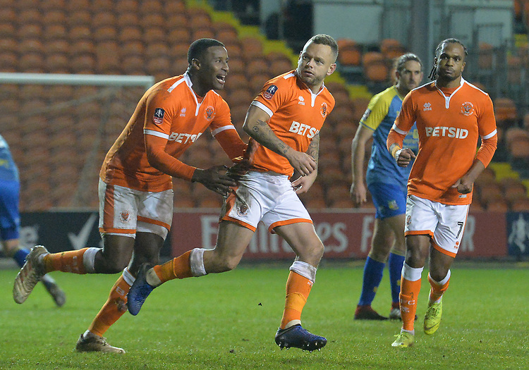 Blackpool's Jay Spearing is congratulated on scoring his team's third goal<br /> <br /> Photographer Dave Howarth/CameraSport<br /> <br /> The Emirates FA Cup Second Round Replay - Blackpool v Solihull Moors - Tuesday 18th December 2018 - Bloomfield Road - Blackpool<br />  <br /> World Copyright © 2018 CameraSport. All rights reserved. 43 Linden Ave. Countesthorpe. Leicester. England. LE8 5PG - Tel: +44 (0) 116 277 4147 - admin@camerasport.com - www.camerasport.com