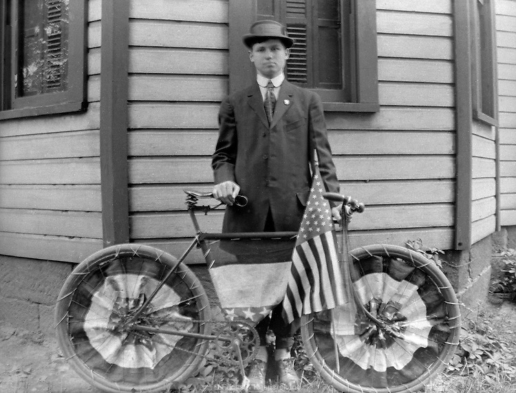 R. G. Lutz poses with his bicycle decorated for Memorial Day in Akron, Ohio. May 30, 1911.