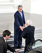 Washington, DC - March 5, 2008 -- United States President George W. Bush, top, welcomes United States Senator John McCain (Republican of Arizona), bottom, the presumptive 2008 Republican nominee for President of the United States for lunch on the North Portico of the White House on Wednesday, March 5, 2008..Credit: Ron Sachs / CNP
