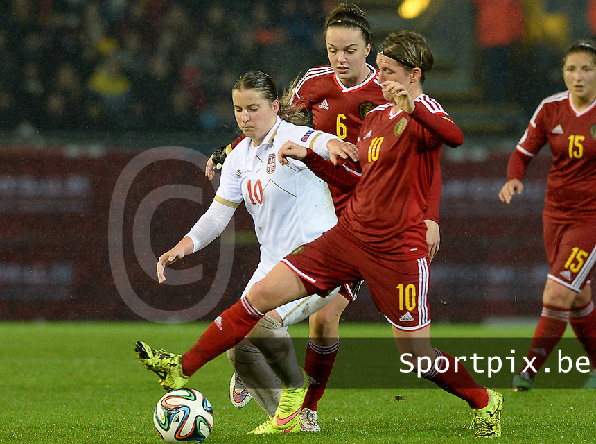 20151130 - LEUVEN ,  BELGIUM : Belgian Aline Zeler pictured in a duel with Serbian Jelena Cankovic (left) during the female soccer game between the Belgian Red Flames and Serbia , the third game in the qualification for the European Championship in The Netherlands 2017  , Monday 30 November 2015 at Stadion Den Dreef  in Leuven , Belgium. PHOTO DAVID CATRY