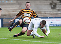 Raith Rovers' Calum Elliot gets in front of Alloa's Jason Marr to head home their third goal.