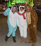 Lisa, Hajnalka and Dave during the Onesie Crawl held on Saturday night, Nov. 18, 2017 in downtown Reno.