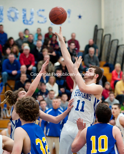BURLINGTON,  CT-021315JS03- Lewis Mills' Trent Millum  (11) puts up a shot over Housatonic's Max Vadakin  (23) during their game Friday at Lewis Mills High School in Burlington. <br />  Jim Shannon Republican-American