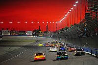 Aug 31, 2008; Fontana, CA, USA; NASCAR Sprint Cup Series drivers race down the backstretch as the sun sets during the Pepsi 500 at Auto Club Speedway. Mandatory Credit: Mark J. Rebilas-