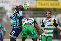 Adebayo Akinfenwa of Wycombe Wanderers wins a header from Nathan Smith of Yeovil Town during the Sky Bet League 2 match between Yeovil Town and Wycombe Wanderers at Huish Park, Yeovil, England on 8 October 2016. Photo by Mark  Hawkins / PRiME Media Images.