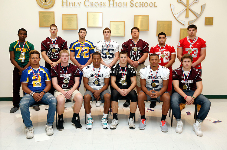 Waterbury, CT- 14 December 2015-121415CM01- The 2015 All-Naugatuck Valley League football offense: front row, from left, Jaylen Kelley (Seymour), Connor Finn (Torrington), Tajik Bagley (Ansonia), Sean McAllen (Woodland), Tyler Bailey (Ansonia), Zak Mancini (Torrington); back row, from left, Tyler Rudolph (Holy Cross), Nathaniel Bresson (Torrington), C.J. Falcioni (Seymour), Keith Zdep (Ansonia), Kobe Covington (Torrington), Jose Santamaria (Derby), Cole Phelps (Wolcott).      Christopher Massa Republican-American