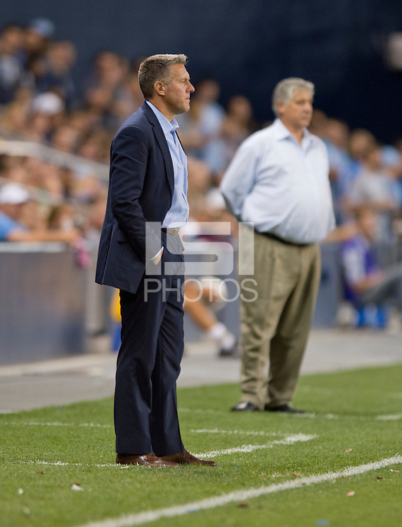 Peter Vermes, Sigi Schmid. Sporting Kansas City won the Lamar Hunt U.S. Open Cup on penalty kicks after tying the Seattle Sounders in overtime at Livestrong Sporting Park in Kansas City, Kansas.