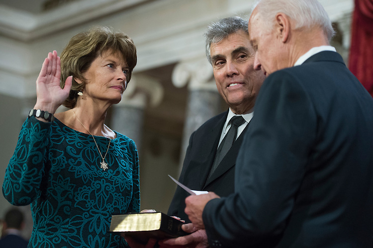 UNITED STATES - JANUARY 03: Sen. Lisa Murkowski, R-Alaska, is administered an oath by Vice President Joe Biden as her husband Verne Martell looks on, during swearing-in ceremony in the Capitol's Old Senate Chamber, January 03, 2017. (Photo By Tom Williams/CQ Roll Call)