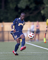 Quinnipiac University forward Demba Sylla (27) passes the ball. Boston College defeated Quinnipiac, 5-0, at Newton Soccer Field, September 1, 2011.