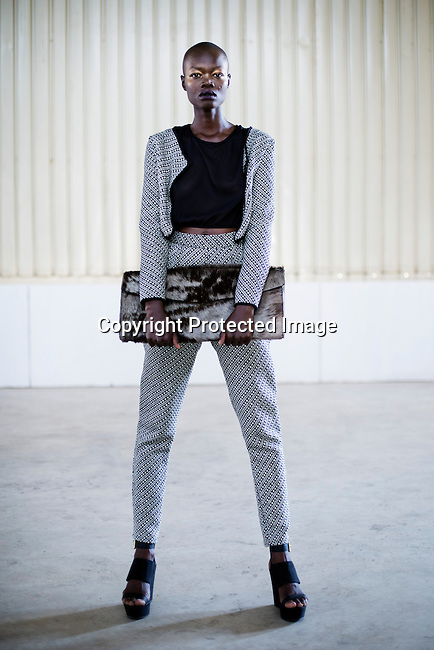 JOHANNESBURG, SOUTH AFRICA MARCH 23: Sudanese model Aluad Anei backstage before a fashion show with design label Bulbulia at MOAD, Museum of African Design during Mercedes Benz Africa fashion autumn/ winter 2014 week on March 23, 2014 held in Maboneng District, Johannesburg, South Africa. Designers showed their best fall/winter collections. (Photo by: Per-Anders Pettersson)