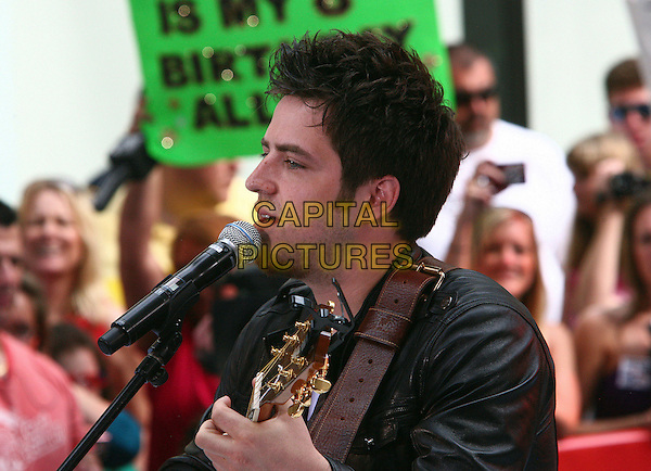 "LEE DeWYZE.American Idol runner up Crystal Bowerox  performs live on NBC's ""Today"", New York, NY, USA..June 3rd, 2010.half length stage concert live gig performance music guitar facial hair  black jakcet guitar profile singing .CAP/ADM/PZ.©Paul Zimmerman/AdMedia/Capital Pictures."