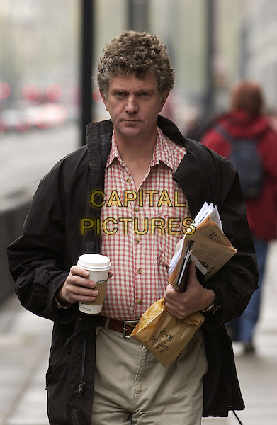 JONATHAN POWELL.Tony Blairs Chief Of Staff at Labour's Campaign HQ Victoria Street, London, England, UK, 23rd April 2005..half length government aide starbucks coffee cup black coat red gingham checked shirt newspaper politics .CAP/FIN.©Steve Finn/Capital Pictures.