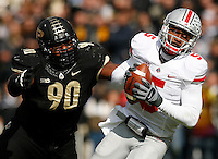 Ohio State Buckeyes quarterback Braxton Miller (5) is pursued by Purdue Boilermakers defensive tackle Bruce Gaston (90) during Saturday's NCAA Division I football game at Ross-Ade Stadium in West Lafayette, In. on November 2, 2013. (Barbara J. Perenic/The Columbus Dispatch)