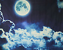 Backdrop featuring a black and dark blue night sky with white moonlit clouds and full moon