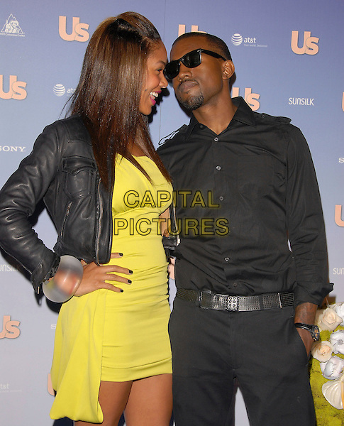 ALEXIS PHIFER & KANYE WEST.The US Weekly Hot Hollywood 2007 Celebration held at Opera in Hollywood, California, USA..September 26th, 2007.half length yellow dress black leather jacket trousers shirt hand in pocket sunglasses shades hand on hip clear bracelet bangle couple profile.CAP/DVS.©Debbie VanStory/Capital Pictures