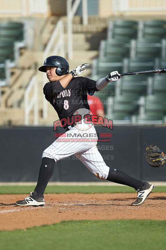 Carlos Perez (8) of the Kannapolis Intimidators follows through on his swing against the Hagerstown Suns at Kannapolis Intimidators Stadium on May 6, 2018 in Kannapolis, North Carolina. The Intimidators defeated the Suns 4-3. (Brian Westerholt/Four Seam Images)