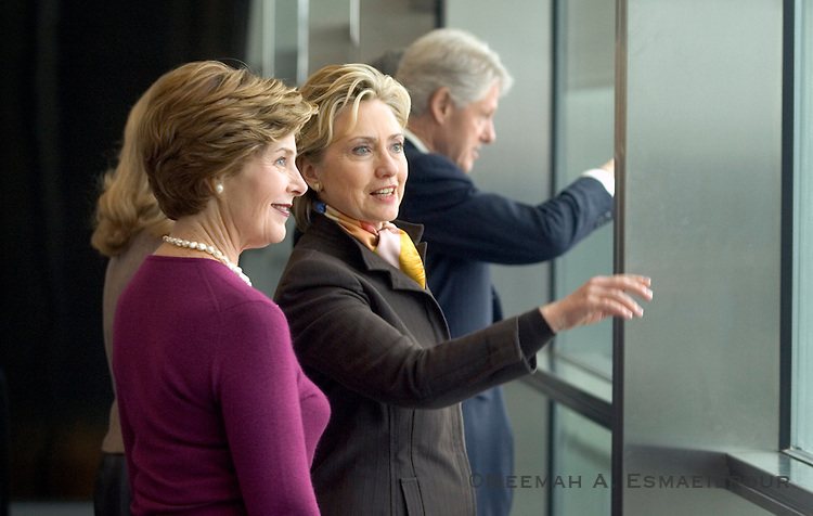 Senator Hillary Clinton gives a tour to First Lady Laura Bush of her husband's new Presidential Library before the official dedication ceremony Friday, Nov 19, 2007 in Little Rock, Arkansas.