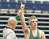 Jack Jones of Bellmore JFK raises his arm after pinning Jack Rosen of Farmingdale at 170 pounds in the Nassau County Division 1 wrestling quarterfinals at Hofstra University on Saturday, Feb. 13, 2016.