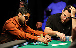 Yunus Jamal and David Paredes compete in a hand against each other.