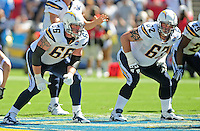 Sep. 20, 2009; San Diego, CA, USA; San Diego Chargers tackle (66) Jeromey Clary and tackle (62) Brandyn Dombrowski against the Baltimore Ravens at Qualcomm Stadium in San Diego. Baltimore defeated San Diego 31-26. Mandatory Credit: Mark J. Rebilas-