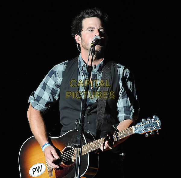 DAVID NAIL.performs live as his 2010 tour makes a stop at The Koka Booth Amphitheater, Cary, North Carolina, USA, 23rd September 2010..country music live on stage concert gig half length guitar playing singing microphone jeans plaid shirt grey gray waistcoat blue checked check .CAP/ADM/MOO.© Moose/AdMedia/Capital Pictures.