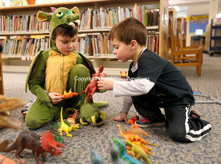Southbury, CT- 14 January 2016-011416CM01  Jacob Skorupski 5, of Southbury, left, and and Daniel Candullo 5  play with dinosaurs at the Southbury Public Library on Thursday.   The pair were at the library for a PJ Storytime event.  Skorupski wore his dragon pajamas.   Christopher Massa Republican-American
