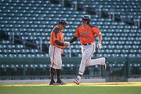 AZL Giants Orange Connor Cannon (13) is congratulated by manager Alvaro Espinoza (99) after hitting a home run during an Arizona League game against the AZL Cubs 1 on July 10, 2019 at Sloan Park in Mesa, Arizona. The AZL Giants Orange defeated the AZL Cubs 1 13-8. (Zachary Lucy/Four Seam Images)
