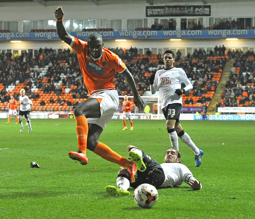 Blackpool's Ishmael Miller is tackled by Derby County's Richard Keogh<br /> <br /> Photographer Dave Howarth/CameraSport<br /> <br /> Football - The Football League Sky Bet Championship - Blackpool v Derby County - Tuesday 21st October 2014 - Bloomfield Road - Blackpool<br /> <br /> &copy; CameraSport - 43 Linden Ave. Countesthorpe. Leicester. England. LE8 5PG - Tel: +44 (0) 116 277 4147 - admin@camerasport.com - www.camerasport.com
