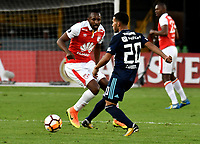 BOGOTA - COLOMBIA - 01 - 03 - 2018: Juan David Valencia (Izq.) jugador de Independiente Santa Fe disputa el balón con Robert Burbano (Der.) jugador de Emelec (ECU), durante partido entre Independiente Santa Fe (COL) y Emelec (ECU), de la fase de grupos, grupo 4, fecha 1 de la Copa Conmebol Libertadores 2018, jugado en el estadio Nemesio Camacho El Campin de la ciudad de Bogota. / Juan David Valencia (L) player of Independiente Santa Fe vies for the ball with Robert Burbano (R) player of Emelec (ECU), during a match between Independiente Santa Fe (COL) and Emelec (ECU), of the group stage, group 4, 1st date for the Conmebol Copa Libertadores 2018 at the Nemesio Camacho El Campin Stadium in Bogota city. Photo: VizzorImage  / Luis Ramirez / Staff.