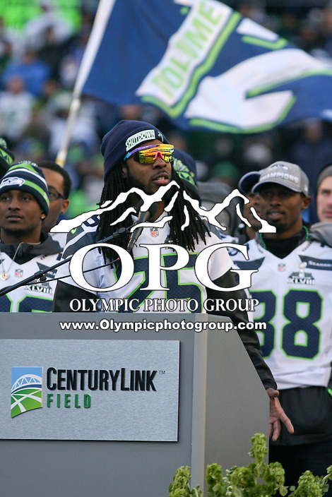 2014-02-05:  Seattle Seahawks corner back Richard Sherman thanks fans in attendance during the Super Bowl Parade.  Seattle Seahawks players and 12th man fans celebrated bringing the Lombardi trophy home to Seattle during the Super Bowl Parade at Century Link Field in Seattle, WA.