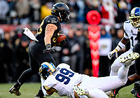 PHILADELPHIA, PA - DEC 8, 2018: Army Black Knights running back Darnell Woolfolk (33) tries to escape a tackle from Navy Midshipmen defensive tackle Jackson Pittman (99) during first half action of game between Army and Navy at Lincoln Financial Field in Philadelphia, PA. Army defeated Navy 17-10 to win the Commander in Chief Cup. (Photo by Phil Peters/Media Images International)