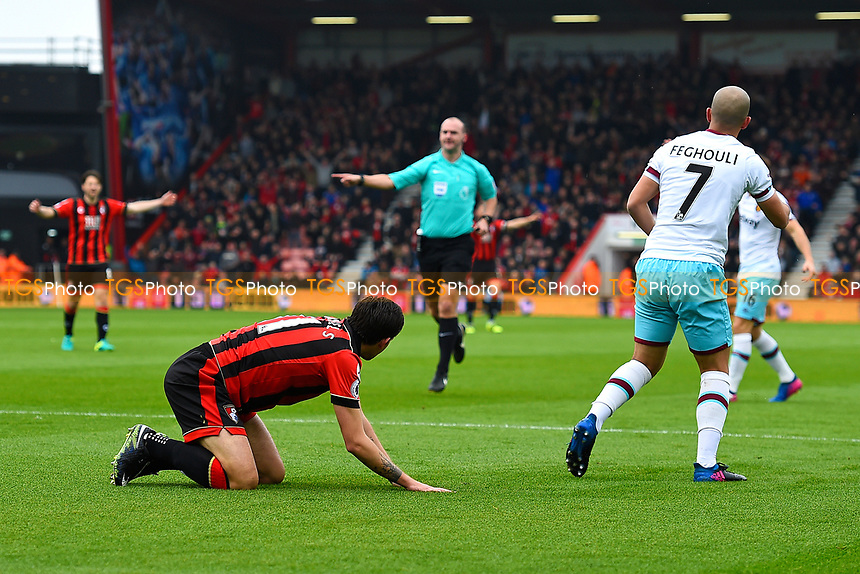 Charlie Daniels of AFC Bournemouth is brought down in the box by Sofiane Feghouli of West Ham United as Referee Robert Madley points to the spot during AFC Bournemouth vs West Ham United, Premier League Football at the Vitality Stadium on 11th March 2017