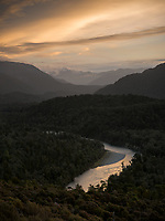 Cascade River with moody sunset over Red Hills in distance, West Coast, South Westland, UNESCO World Heritage Area, New Zealand, NZ