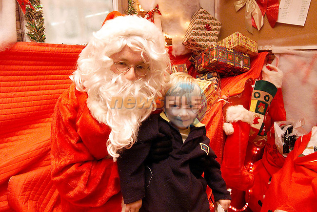 Darragh Brady from Mell with Santa in QMart..Picture: Paul Mohan/Newsfile