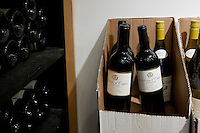 Bottles on display in a cardboard box and on shelves at Chambers Street Wines in New York, NY, USA, 22 May 2009. The store specializes in naturally made wines from artisanal small producers and has received a Slow Food NYC Snail of Approval.