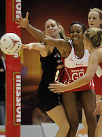 09.07.2011 Silver Ferns Casey Williams and England's Pamela Cookey in action during the netball match between Silver Ferns and England at the Mission Foods World Netball Championship 2011 held at the Singapore Indoor Stadium in Singapore . Mandatory Photo Credit ©Michael Bradley.