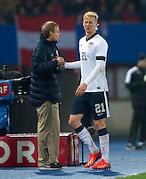 VIENNA, Austria - November 19, 2013: Manager Jurgen Klinsmann and Brek Shea during a 0-1 loss to host Austria during the international friendly match between Austria and the USA at Ernst-Happel-Stadium.