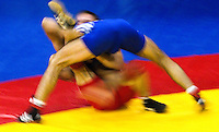 17 JUL 2010 - SHEFFIELD, GBR - Krasimir Krastanov (GBR) (blue) attempts to pin Alexandru Chirtdeca (MDA) (red) during their GB Cup match (PHOTO (C) NIGEL FARROW)