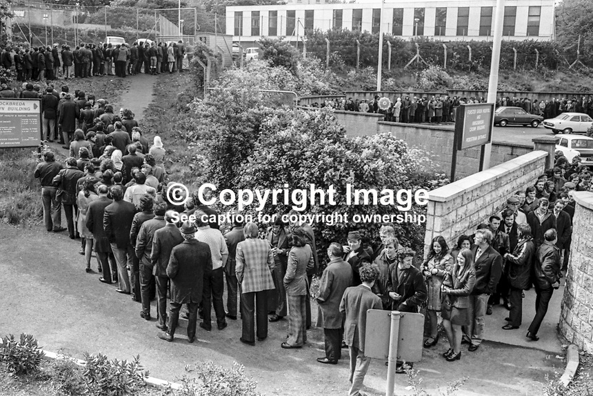 Dole queues lengthened dramatically during the UWC strike as evidenced by this particularly long queue at the employment exchange at Knock, East Belfast, N Ireland.  May 1974. 197405002165<br />
