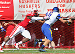 LINCOLN, NE - SEPTEMBER 21, 2013:  Avery Moss #94 of Nebraska grabs South Dakota State quarterback Austin Sumner #6 during their college football game Saturday at Memorial Stadium in Lincoln, NE.  (Photo by Dick Carlson/Inertia)