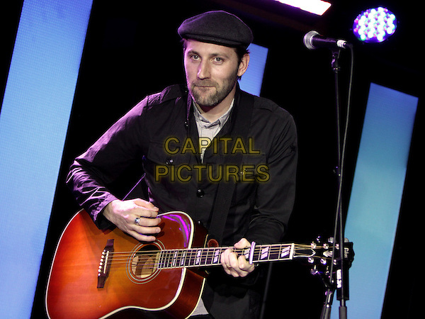 MAT KEARNEY.Recording artist Mat Kearney performed for the attendees at Blissdom 2011 held at the Gaylor Opryland Resort, Nashville, TN, USA..January 27th, 2011.stage concert live gig performance music half length black cap hat jacket guitar beard facial hair .CAP/ADM/DH.©Dan Harr/AdMedia/Capital Pictures.