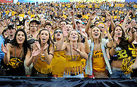 SEPTEMBER 17, 2011:   Female Colorado Buffaloes superfans cheer   during an inter-conference game between the Colorado State Rams and the University of Colorado Buffaloes at Sports Authority Field at Mile High Field in Denver, Colorado. The Buffaloes led 14-7 at halftime*****For editorial use only*****