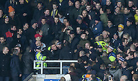 A fight breaks out amongst supporters as police battle to gain order during the Johnstone's Paint Trophy Southern Final 2nd Leg match between Oxford United and Millwall at the Kassam Stadium, Oxford, England on 2 February 2016. Photo by Andy Rowland / PRiME Media Images.
