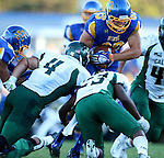 BROOKINGS, SD - SEPTEMBER 6:  Jason Schneider #83 from South Dakota State University leaps over Cameron Ontko #4 and Dave Douglas #23 from Cal Poly in the first half of their game Saturday evening at Coughlin Alumni Stadium in Brookings.(Photo/Dave Eggen/Inertia)
