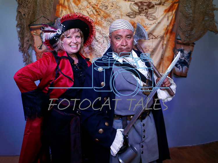 Gerald Reyes, who appeared in two of the Pirates of Caribbean movies, poses for photos with Carson City Classic Cinema Club founder Rhonda Abend at the Scallywaggers Pirate Pup Parade at the Brewery Arts Center, in Carson City, Nev., on Wednesday, Sept. 18, 2019.<br /> Photo by Cathleen Allison/Nevada Momentum
