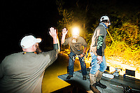 Shanon Lanphar (cq), Briceson Lanphar (cq, age 14) an Travis Lanphar (cq) with team Twisted Limbs from Haines City, Florida, fish during the U.S. Open Bowfishing Championship, Saturday, May 3, 2014. <br /> <br /> Photo by Matt Nager