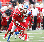 UK senior cornerback Martavius Neloms tackles UL sophomore wide receiver Kai Dominguez during the first half of UK vs. UL football game at Papa John's Cardinal Stadium in Louisville, Ky., on Sunday, September 2, 2012. Photo by Tessa Lighty | Staff