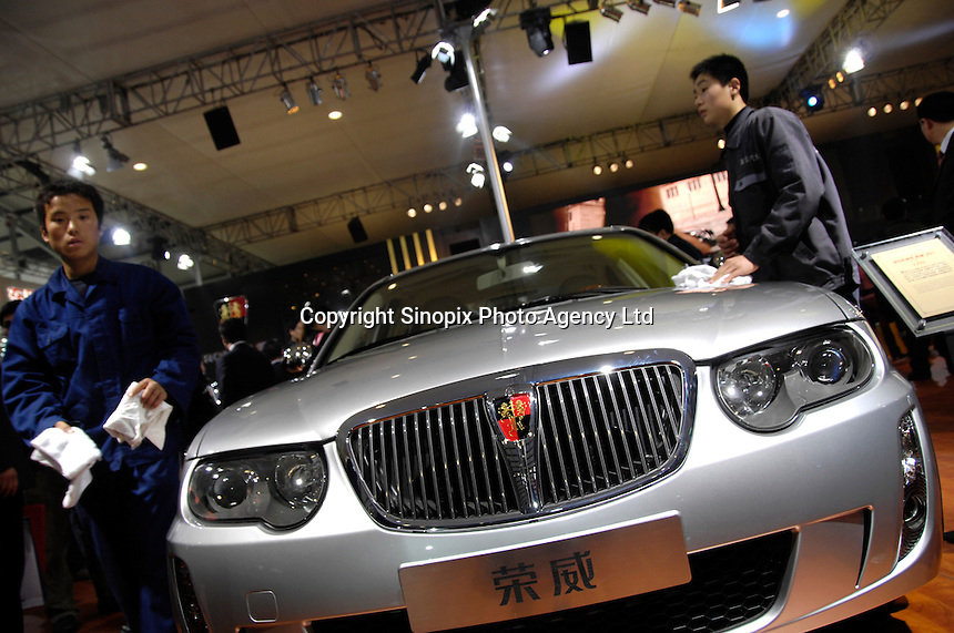 Chinese men clean a Roewe 750, Shanghai Automotive (SAIC)'s first own-brand model based on the Rover 75 platformfrom,  at the 2006 International Automotive Exhibition in Beijing, China..19 Nov 2006