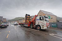 Pictured: The Banksy is transported on a flat bed lorry through Dyffryn Road. Wednesday 29 May 2019<br /> Re: Contractors are working to move Banksy's Season Greeting, now owned by John Brandler, which appeared on a garage wall in Port Talbot, to a new location in the same town in south Wales, UK.