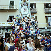 People sit on their Gigli, during Festa dei Gigli, in Nola, Italy, 2010. A Gigli is a 25 meter high float honoring and celebrating the fertility of the country side around Nola. The festival continues this tradition each year...PHOTOS/ MATT NAGER